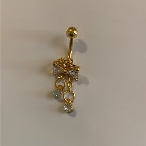 Gold bow belly button ring